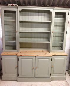 dresser/sideboard for home salon storage, frost/material over the doors/shelves so it hides everything away