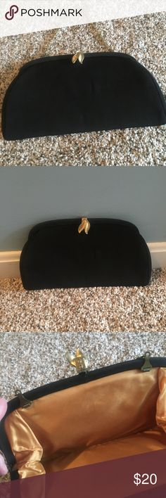 Vintage black clutch or wrist purse! You can fit a lot in this vintage clutch with gold interior and gold clasp and chain handle. Vintage Bags Clutches & Wristlets