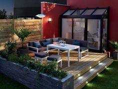 Belle terrasse en bois chic et idéal pour les soirs d'été