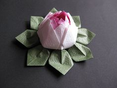 I like this one (Origami Lotus Flower) even better! The textured paper and gradient effect are lovely. $5.50 on Etsy! Would be great in place of a bow on a present.