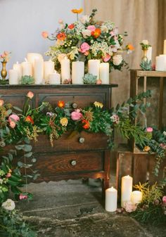 candles + flowers in a chest of drawers http://weddingwonderland.it/2015/11/candele-matrimonio.html