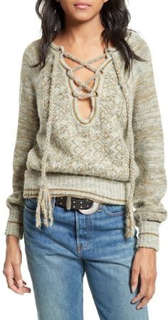 Women's Free People Lace-Up Sweater.Dress for the chill and cozy up in this plush sweater knit with tonal yarns and a cool lace-up neckline.