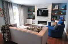 Blue and Grey Family room designed by Koffeetree Art & Design