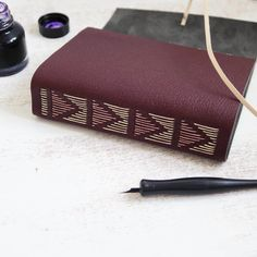 Leather journal with hand sewn triangle design on spine bound by Dani Fox Books
