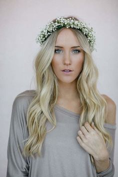 It's pretty dreamy to think about walking down the aisle in a wedding hairstyle with flowers. For the boho gals, their hair in loose, long waves