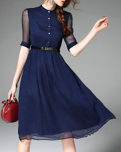 It's the details that make this dress. Modern with a vintage touch in the dual layer and fit.