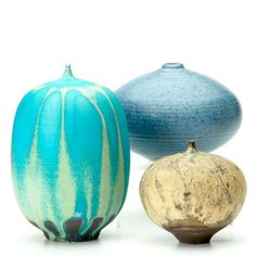 "CABAT/HEINO Two early Cabat Feelies, one turquoise and one beige, and one squat Heino vessel with small opening, covered in matte light blue glaze. All marked. Tallest 5"", Estimate- $850, Winning Bid: $1,800"