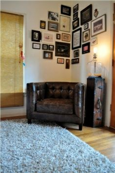 "photo idea...maybe for the ""man cave"" room.I like the idea of using the corner for trophies or pictures."