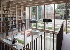 Extension featuring larch-framed box that stretches along rear elevation