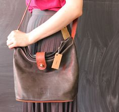 large leather tan and black bucket bag by cheapopulance on Etsy, $35.00