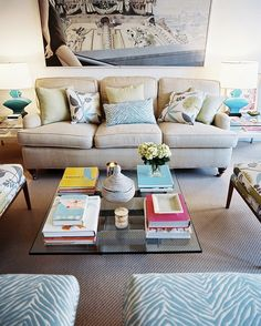 Neutral sofa + colorful accents.