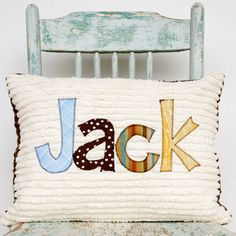 A Monogrammed Pillow Cover for the Home and Nursery in MOUNTAIN, Personalized with Your Baby or Toddler Boy's First Name in Primary. $42.00, via Etsy.