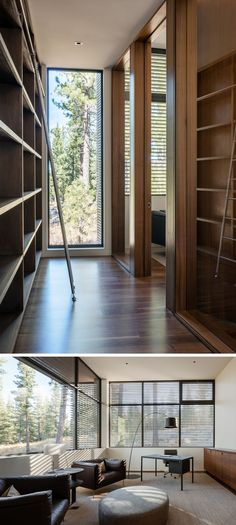 A floor-to-ceiling wood bookcase lines the hallway that leads to this modern home office. Large windows, and various furniture allow for this office to be a great working space.