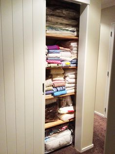 Organized linen cupboard. It's all in the folding and vacuum pack bags.