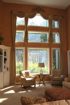 Shade tree interiors handling 2 story windows with for Arched bay windows