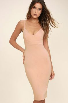Lulus Exclusive! Some things are better kept a secret, so feel free to leave them wondering where you discovered the Don't Tell 'Em Blush Pink Bodycon Midi Dress! Feeling fierce will come easily in this stretch knit number, with skinny spaghetti straps and a darted triangle bodice above a banded waist. The midi length skirt (with kick pleat at back) creates a sleek bodycon look, complementing your curves for an elegant finish. Hidden back zipper.