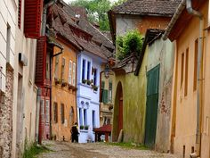 Sighisoara, Romania. My FAVORITE Romanian village. Adorable. Friendly people. Cheap, delicious pizza. GO!