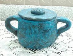 Pote de cerâmica.
