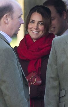 Kate manages one of her great smiles on Christmas Day 12-25-12 outside of St. Mark's Church in Englefield, England