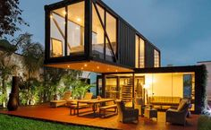 """The structure of the """"Casa Reciclada"""" comprises of three shipping containers. Two of them are 20 feet on the main floor, and one is 40 feet on the subsequent floor. Fujimori clarifies that the plan is made for a youthful couple for a wide open living. Building A Container Home, Container Buildings, Container Architecture, Container Cabin, Sustainable Architecture, Cargo Container, Container Store, Contemporary Architecture, Architecture Design"""