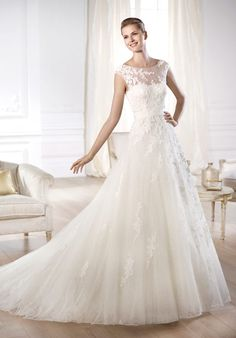 This A-line wedding dress (Ofira from Pronovias) with embroidered tulle under a layer of ivory tulle is seriously making my heart flutter.