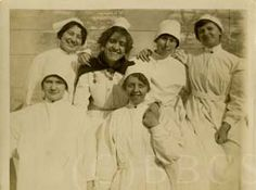 One Graduate Nurse in Double Frill, PGH Nurse, Four Student Nurses in Isolation Uniform, c1900, PGH Collection. Image courtesy of the Barbara Bates Center for the Study of the History of Nursing.