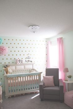 Dutailier Comfort Classico Glider in grey. via Project Nursery - Mint and Pink Nursery with Gold Dot Accent Wall