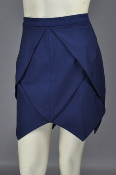 $48   This midnight blue origami skirt adds interest to what may usually be a boring navy skirt with its layered cut. The quality of this skirt shows in its thickness and top to bottom zipper closure.
