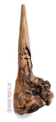 """""""Uncertainty of Time""""    12½ inches tall and 4 inches wide  He hangs showing his wizard's ¾ profile.   Signed and dated:   N. Tuttle 7/27/14"""