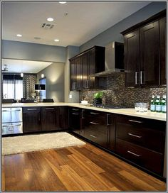 dark cabinets, light wood floor