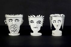 Faces made from plastic foam cups by Mark Swidler, using only a pocket knife.