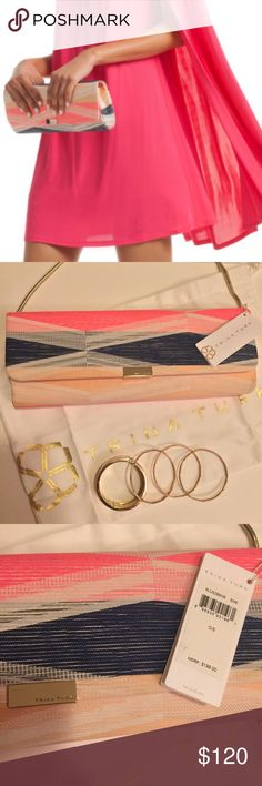 Beautiful Trina Turk Clutch💕 The style and color is gorgeous and the added gold strap and hardware makes it such a timeless piece.  The bag is structured.  It is large enough to hold your small wallet, keys, phone and gloss.  The shoulder strap is removable.  I have never used this bag and it's too pretty to sit in a closet. Please note the small areas on the outside of the bag--I tried to capture them in the pics above.  The spots are not that noticeable unless up close. Trina Turk Bags…