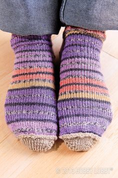 If you're thinking short and sweet, think snug little anklets! Knitted from stretchy self-striping yarn, these socks were a cinch on our simple sock loom. For extra pizzazz, we made the heel and toe pieces separately. Then we stitched them into place.