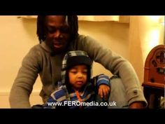 2 year old rapping with his dad, just like real rappers, can't understand a word he says but cute.