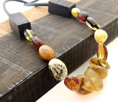 one of a kind necklace by Neshka amber, ebony wood, leather, silver