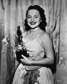 "Olivia de Havilland with Oscar for ""To Each His Own"" (1947)"