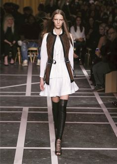 White technical Charmeuse + Black/Brown sleeveless leather jacket, boots with laces. Spring 2017, Givenchy.