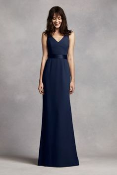 You will look alluringin this elegant crepe gown!  Sleeveless crepe bodice withdeep-Vneckline features satin straps and waist band.  Open back detail is eye-catching and adds drama.  Fully lined. Back zip. Imported polyester. Dry clean only.