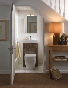 Did you know you could turn an under stairs space into a small bathroom? Just install a cute toilet sink combo and add a mirror above it. Space Under Stairs, Bathroom Under Stairs, Basement Bathroom, Toilet Under Stairs, Basement Stairs, Bathroom Closet, Basement Ideas, Bathroom Plumbing, Cloakroom Toilet Downstairs Loo