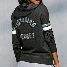 """Coming Soon! Victoria's Secret Full Zip Hoodie NWT Coming soon!  Brand NWT! Classic fleece hoodie by VS features sequin-covered graphic """"Victoria's Secret"""" and sequin & stripe embellished sleeves, full zipper, front pockets, and ribbed trim hems. Extra cozy & cute!  Dark charcoal gray with teal & white accents. Size Medium.  NO TRADES OR PP. Victoria's Secret Tops Sweatshirts & Hoodies"""
