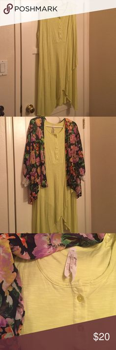 Melissa McCarthy  dress NWOT. Just wasn't my personal style. Soft sturdy material. Super cute dress to throw on and be ready to go! A unique color, yellow/lime. Melissa McCarthy Dresses High Low