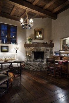 wood floors and stone fireplace - rustic