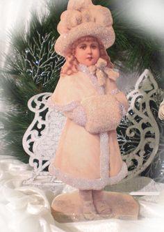 beautiful Winter-girl with muff... Tolles Winter-Mädchen mit Muff vor ihrem Schlitten