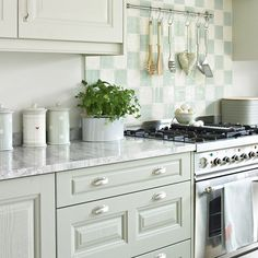 Bring a fresh new look to a kitchen by painting the units. A pale green creates a warming feel in a practical space in this charming kitchen