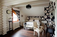 twist on rustic look with painted white logs and fun oversize floral print--pretty bedroom