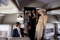Behind the scenes A natural with cameras, Princess Diana chuckles at a seated Prince Charles aboard a plane during their royal flight to Australia during a royal tour of the Pacific