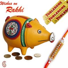 Picture of Hand painted Piggy bank with Rakhi Birkenstock, Send Birthday Gifts, Hampers Online, Hand Pictures, Rakhi Gifts, Gift Cake, Gift Hampers, Gift Certificates, Piggy Bank