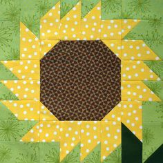 "I found this 12"" Sunflower block in the book Happy Birthday Kansas! by Linda Frost and published by Kansas City Star Books.  It's the ninth block of my Irish Great-Grandpa Sampler Quilt.   While my ma"