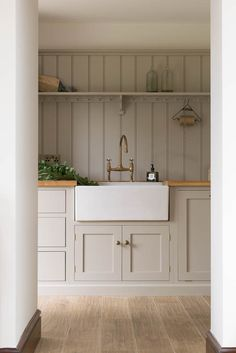 modern farmhouse kitchen, laundry room, or mudroom with light gray taupe cabinets and farmhouse sink Painting Kitchen Cabinets, Kitchen Paint, New Kitchen, Kitchen Decor, Kitchen Ideas, Taupe Kitchen Cabinets, Kitchen Colors, White Cabinets, Kitchen Interior