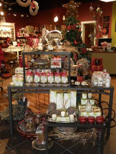 Rustic holiday scents and decor table.  Visual Merchandising by Flourish Design & Merchandising for Baskets in the park.  Display, holiday, retail.